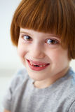 Cute smiling girl missing front teeth Stock Photos