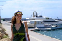 Cute smiling girl near a yacht stock image