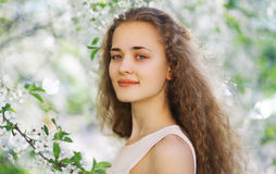 Cute smiling girl outdoors, sunny spring portrait young girl. Curly hair Stock Image