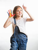 Cute smiling girl with painted face and hands drawing in the air. Portrait of cute smiling girl with painted face and hands drawing in the air stock photography