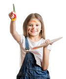 Cute smiling girl with painted face posing with paint palette Stock Image