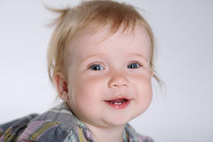 Cute smiling girl. Photo of little cute smiling girl on white Stock Images