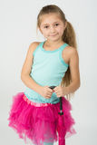The cute smiling girl in a pink skirt Royalty Free Stock Photos