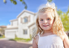 Cute Smiling Girl Playing in Front Yard Royalty Free Stock Image