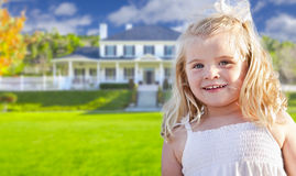 Cute Smiling Girl Playing in Front Yard. Of House Royalty Free Stock Image