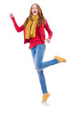Cute smiling girl in red jacket and jeans isolated Stock Photography