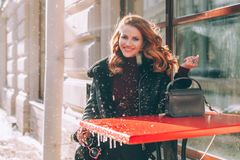 Cute Smiling Girl with Red Long Hair in Street Cafe. Street Fashion Portrait stock photos