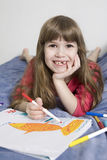 Cute smiling girl seven years old. Little cute smiling girl seven years old  drawing picture Stock Images