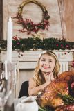 Cute girl at holiday table stock photography
