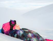 Cute smiling girl in ski clothes. Against the background of the winter landscape Stock Image
