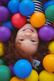 Cute smiling girl in sponge ball pool Stock Photography
