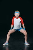 Cute smiling girl in sportswear exercising and looking at camera. Activities for children concept Royalty Free Stock Image