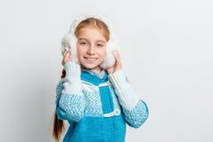 Cute smiling girl in warm fur headphones Stock Photography