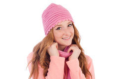 Cute smiling girl wearing scarf and cap isolated Royalty Free Stock Images