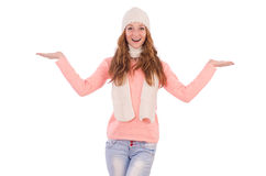 Cute smiling girl wearing scarf and cap isolated Stock Image