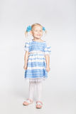 Cute smiling girl on a white background Royalty Free Stock Photography