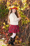 Cute smiling girl in wreath of red viburnum Royalty Free Stock Photos