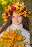 Cute smiling girl in wreath of red viburnum Stock Photography