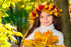 Cute smiling girl in wreath of red viburnum Royalty Free Stock Photography