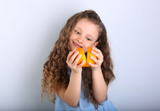 Cute smiling happy kid girl with curly hair style holding and pl Stock Photos
