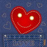 Cute smiling heart in jeans pocket Stock Photo