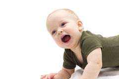 Cute smiling infant kid on white background. Funny laughing baby boy laying on the white blanket Royalty Free Stock Photos