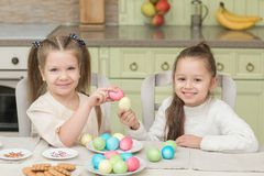Cute smiling kids holding painted easter eggs Royalty Free Stock Photography