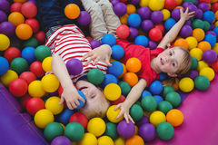 Cute smiling kids in sponge ball pool Stock Image