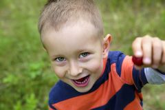 Cute smiling little boy outdoors stock photography
