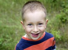 Cute smiling little boy outdoors stock photo