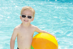 Little Boy Playing at the Pool Royalty Free Stock Photos