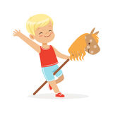 Cute smiling little boy riding on wooden stick horse, colorful character vector Illustration Stock Image