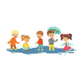 Cute smiling little boys and girls jumping and splashing through the puddles, kids playing in the rain cartoon vector Royalty Free Stock Photo
