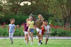 Cute smiling little children playing. In park stock image
