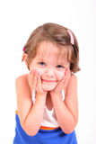 Cute smiling little girl. Little girl with a surprised, smiling look stock photography