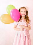 Cute smiling little girl with balloons Royalty Free Stock Images