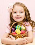 Cute smiling little girl with basket Stock Image