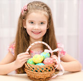 Cute smiling little girl with basket full of easter eggs Royalty Free Stock Photography