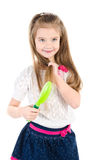 Cute smiling little girl brushing her hair isolated Royalty Free Stock Image