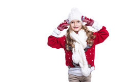 Cute smiling little girl with curly hairstyle wearing knitted sweater, scarf, hat and gloves isolated. Stock Image