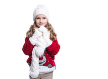 Cute smiling little girl with curly hairstyle wearing knitted sweater, scarf, hat and gloves isolated on white background. Stock Photo