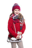 Cute smiling little girl with curly hairstyle wearing knitted sweater, scarf, hat and gloves with skates isolated on white. Royalty Free Stock Photography