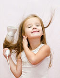 Cute smiling Little girl dries hair Stock Photography