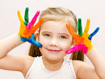 Cute smiling little girl with hands in paint Stock Photos