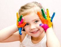 Cute smiling little girl with hands in paint Stock Photography