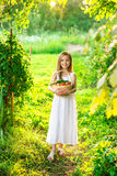 Cute smiling little girl holds basket  with fruit and vegetables Royalty Free Stock Image