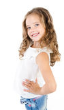 Cute smiling little girl in jeans isolated Stock Photography