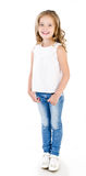 Cute smiling little girl in jeans isolated Stock Images