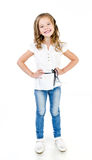 Cute smiling little girl in jeans isolated Stock Photo