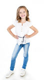 Cute smiling little girl in jeans isolated Royalty Free Stock Photo